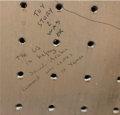 A pegboard with two different handwritings