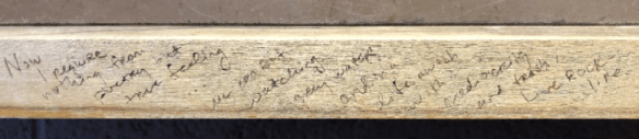 A rim of soft wood with faint writing