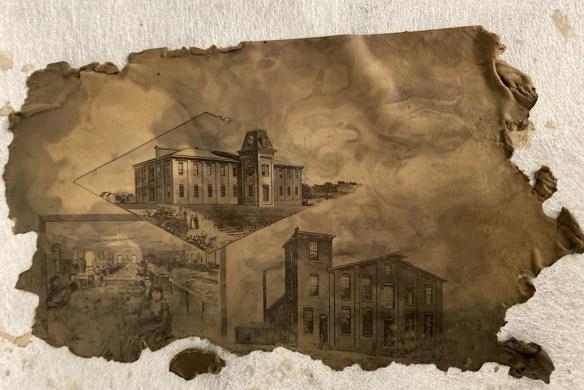 Photo shows a sheet showing large estate homes. Relative to the materials shown in other photos in this article, it is clean.