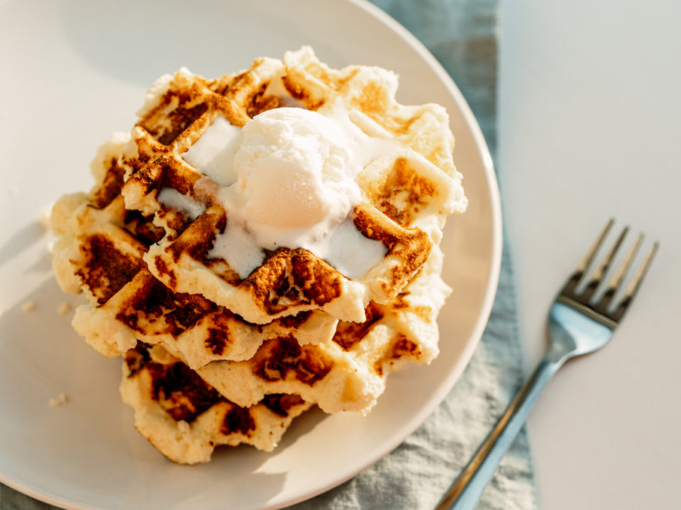 Stack of ricotta waffles on a plate