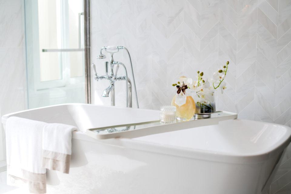 close up chrome faucet shower bath