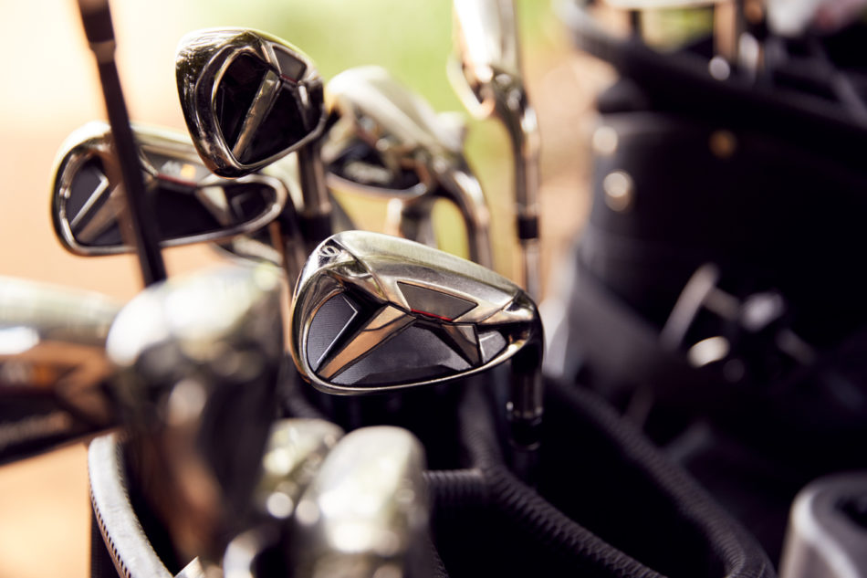 Close Up Of Clubs In Bag On Golf Buggy