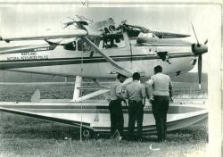 Photo of officers looking at damaged seaplane