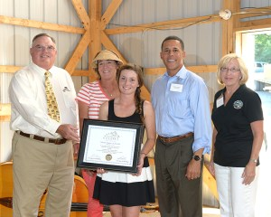 Ashley Foster accepts the September 2013 Touch of Class Award with (from left) MHIB Chair Jim Steele, her mother Patty Foster, Lt. Governor Anthony Brown, and Agriculture Deputy Secretary Mary Ellen Setting.
