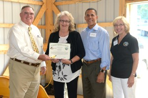 Kathy Howe accepts a Secretary's Citation upon her retirement after 24 years as executive director of Day End Farm Horse Rescue. Presenting are (from left) MHIB Chair Jim Steele, Lt. Governor Anthony Brown and Agriculture Deputy Secretary Mary Ellen Setting.