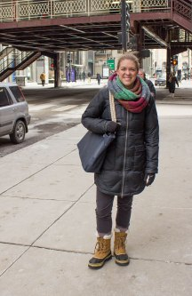 Katy Sakats, Uptown, blends fashion and comfort in her Sorel snow boots. A multicolored infinity scarf adds a much-needed pop to a dark winter coat. (Mallory Hughes / Medill)