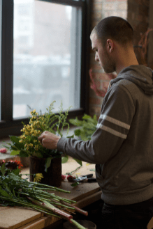 Hayden Regina's passion for floral design motivates him to get up around 6 a.m. every morning to pick up flowers from wholesalers. (Jin Wu/Medill)