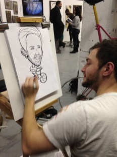 Cory Amos, caricature artist, drawing a self-portrait (Shanley Chien/Medill)