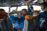 Pilots in the cockpit of the NOAA P-3 aircraft, also known as the Hurricane Hunter, prepare for takeoff. The aircraft, usually used to fly into hurricanes, did double duty to study elevated thunderstorms for the PECAN project.
