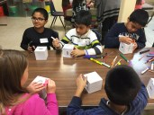 Children from Religious School of Oak Park Temple and Muslim Leadership Academy of the Islamic Foundation Mosque painted Tzedakah and Sadaqah boxes. (Nausheen Akhter/Muslim Leadership Academy)