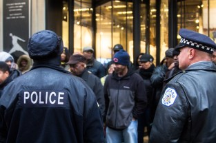 Police stand near the blockade of the Nike store on Michigan Avenue