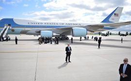 President Obama prepares to exit plane