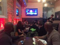 People follow election coverage on television at a restaurant in Chicago. (Fariba Pajooh/MEDILL)