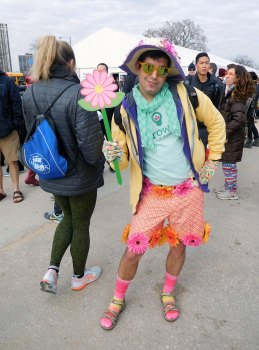 Stefan Rodriguez, 27, dresses up as a flower for his first Polar Plunge, inspired by GrowIt!, the mobile gardening app and startup company that he works for. (Katie Watkins/MEDILL)