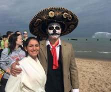 "Miguel Colon and his cousin Jessica Venegas wait in line for their turn to enter the water. Colon is dressed as Mexican revolutionary figure Emiliano Zapata ""raised from the dead."" (Katie Watkins/MEDILL)"