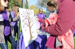 "Treatment centers set up booths throughout the walk with both information and activities. The Renfrew Center of Northbrook, Illinois asked survivors to add their purple thumbprint ""leaves"" on a tree. Purple is considered the official ribbon color for eating disorder awareness. (Colleen Zewe/MEDILL)"