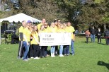 """Her family and friends came to support her as """"Team Sunshine."""" They wore matching yellow shirts printed with the phrase """"you are my sunshine,"""" a phrase that helped Mikret remain positive during the hard days of her treatment. (Colleen Zewe/MEDILL)"""