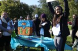 """""""The pinata scale smash is meant to break down the feelings behind a scale and how it might affect those who have eating disorders and how it makes you feel inside,"""" said Natasia Sales, a NEDA volunteer and DePaul student. (Colleen Zewe/MEDILL)"""