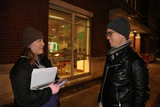 After a slow start, DSA volunteers Virginia Iungerich, 25, and Colin Hill, 27, compare notes on how many flyers they passed out. (Becky Dernbach / MEDILL)