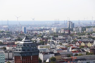 """Wind turbines sprout across the landscape of Hamburg, Germany. Hamburg earned the title of """"Europe's Green Capital"""" for 2011 for its environmental efforts and focus on sustainability. (Jillian Melero/Medill Reports)"""