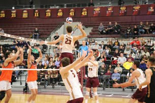 Loyola's Paul Narup (23) rises for a swing on a middle set. Narup was one of four Ramblers to record ten or more kills against Pepperdine. (Tim Hackett//Medill)
