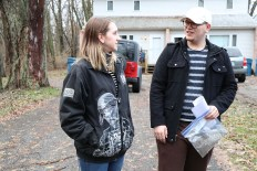 Beth Braun and her friend Mikey Reid take some time to catch up before collecting soil samples. (Becky Dernbach/MEDILL)