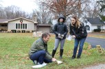 Gabriel Filippelli, Stephanie Fox and Beth Braun collect a soil sample. (Becky Dernbach/MEDILL)