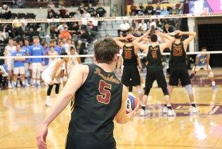 """Collin Mahan readies a serve in the third set against UCLA. """"I thought we served the ball really well, after we made some, somewhat, sweeping changes"""" from the previous week, head coach Mark Hulse said postgame. (Tim Hackett//Medill)"""