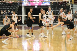 Loyola's Garrett Zolg lunges to get his hand on a shot from Penn State outside Henrik Falck Lauten (back right). Zolg finished with 57 assists and 11 digs, both career-highs, for his first-ever double-double. (Tim Hackett//Medill)