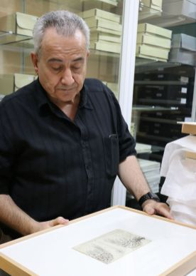 """Juan de Carlos displays one of Cajal's drawings. """"It's a hobby,"""" he says of his responsibility to maintain the Cajal legacy. """"When I start to talk about Cajal I can't stop."""" De Carlos has written two books and several papers about Cajal's influence on neuroscience. (Valerie Nikolas/MEDILL)"""