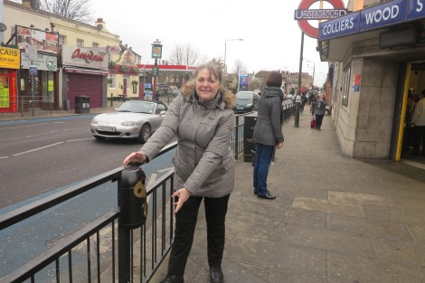 Councillor Judy Saunders with one of the gum and butt bins outside Colliers Wood Station.