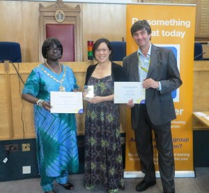 The Mayor of Merton Councillor Agatha Akyigyina and Councillor Nick Draper present Carolyn Choong with the Highly Commended award for 10 years service and with the Outstanding Contribution Award