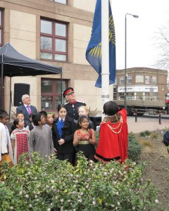 Mayor of Merton, Councillor Agatha Akyigyina raising the Commonwelath flag with Sir John Wheeler, Leader of the Council, Councillor Stephen Alambritis and pupils from local schools.