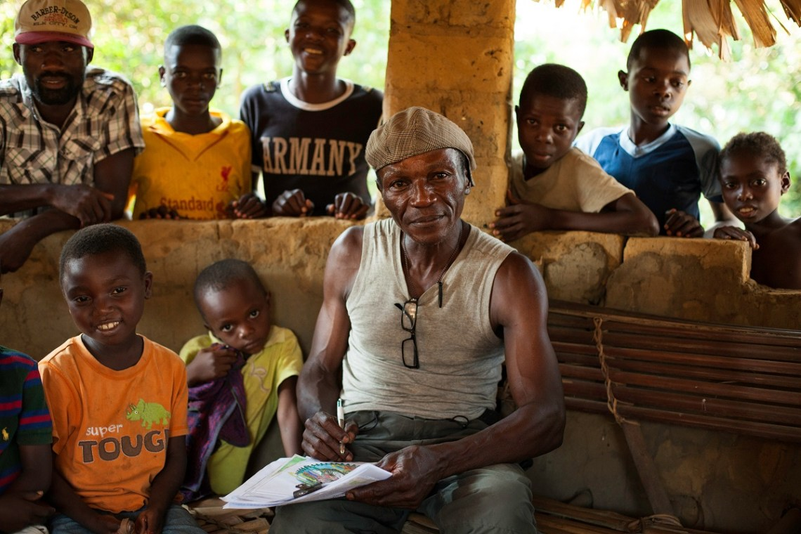 Wally, drawing to educate and raise awareness about environmental conservation among his community neighboring the Salonga National Park, Monkoto, Tshuapa, DRC, October 2016. Photo by Leonora Baumann for Mongabay.
