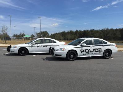 Gwinnett police officer struck by vehicle directing school
