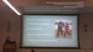 Presenter discussing rape aggression defense prevention