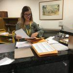 Megan preparing certificates for mailing