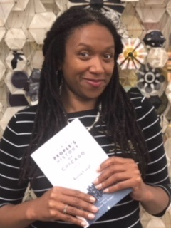 "Juanita Harrell holding the book ""A People's History of Chicago"""