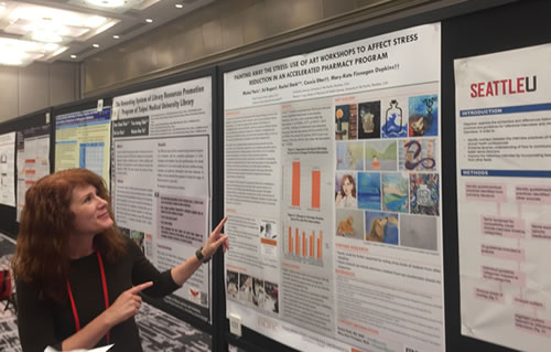 Mary-Kate Finnegan presenting a poster at a symposium