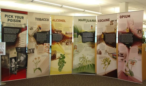 Banners with individual topics on tobacco, alcohol, marijuana, cocaine and opium for the Pick Your Poison exhibit