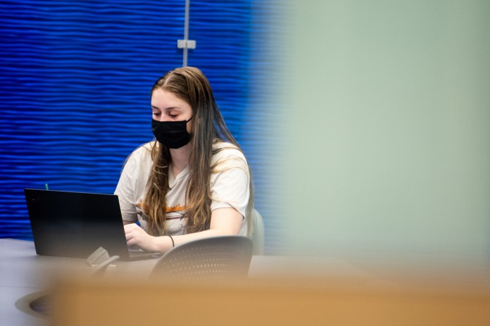 student studying in snell library