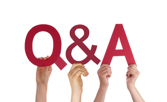 Many Caucasian People And Hands Holding Red Straight Letters. Or Characters Building The Isolated English Word Q And A Means Questions And Answers On White Background