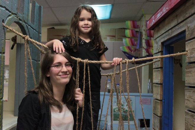Kailey Wartinger, 4, and her aunt Katie Wartinger play on a castle fort at North City Co-op, part of Shoreline Community College's network of co-ops.