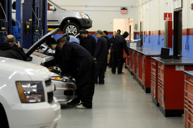 Shoreline Community College students work on cars in the Automotive department.