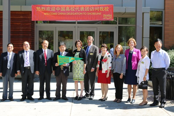 President Cheryl Roberts (center) and members of the delegations from Shoreline and Hainan Open University.