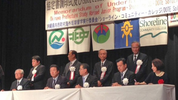 Shoreline Community College President Cheryl Roberts (at right) signs a memorandum of understanding with a group of mayors in Okinawa, Japan, that could bring more Okinawan students to Shoreline. Photo gallery