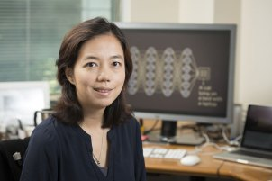 Fei-Fei Li at her desk