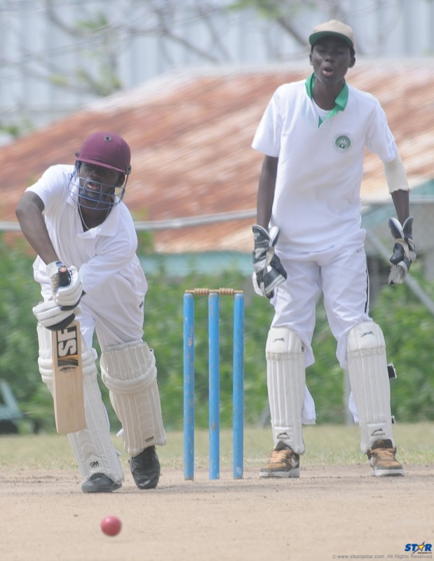 A player from Babonneau Secondary School at bat during a match against Ciceron Secondary School on the Gros Islet Playing Field.