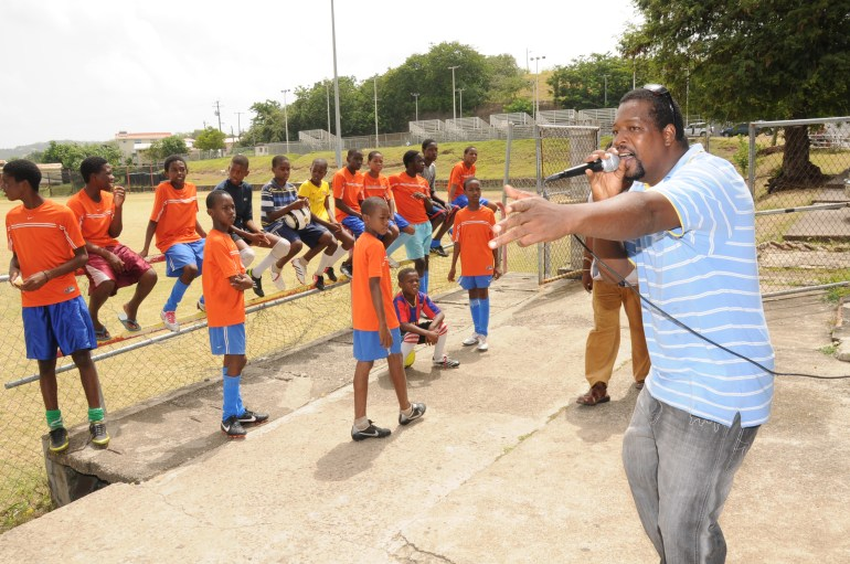 Gros-Islet Youth Footballers being entertained prior to a training session.