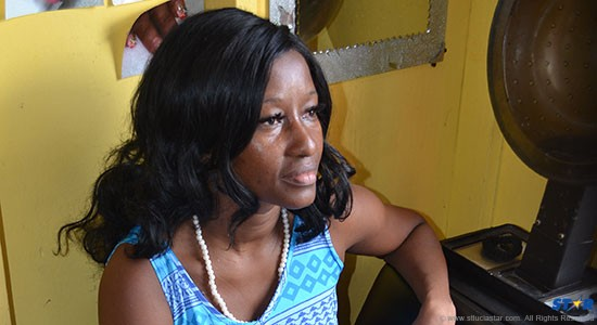 Beverly Thomas at her salon on Thursday as she ponders the actions of local police against her on Monday and Tuesday.
